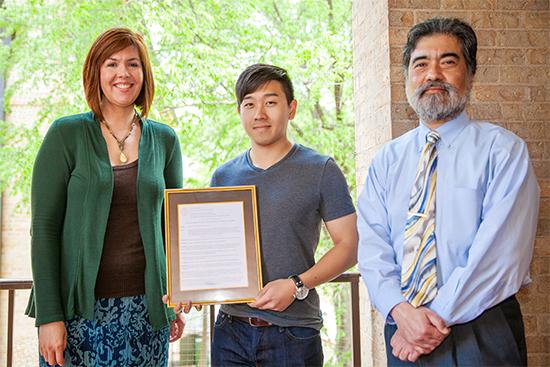 Sanger Center representatives with award