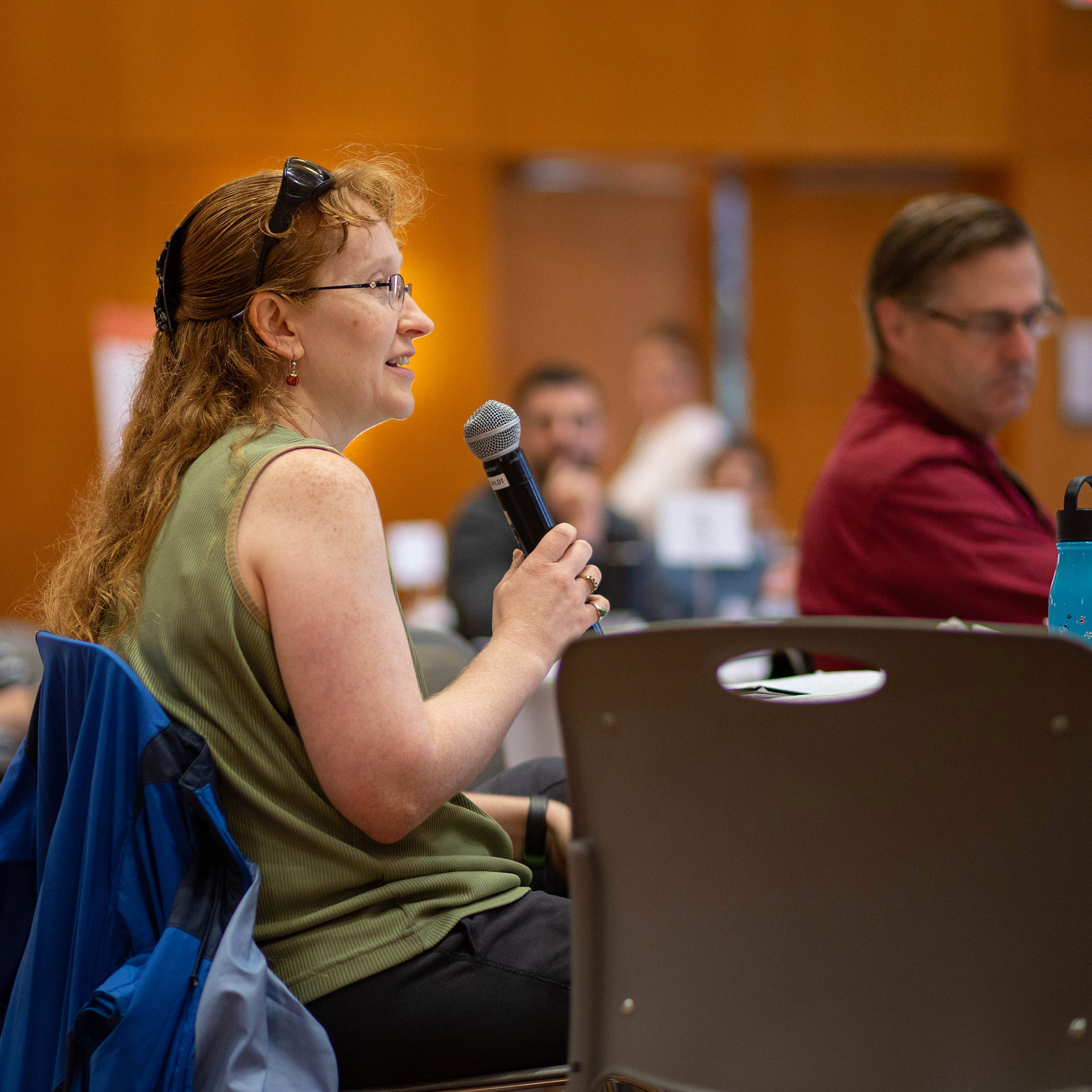 An audience member asks a question at the Flags symposium