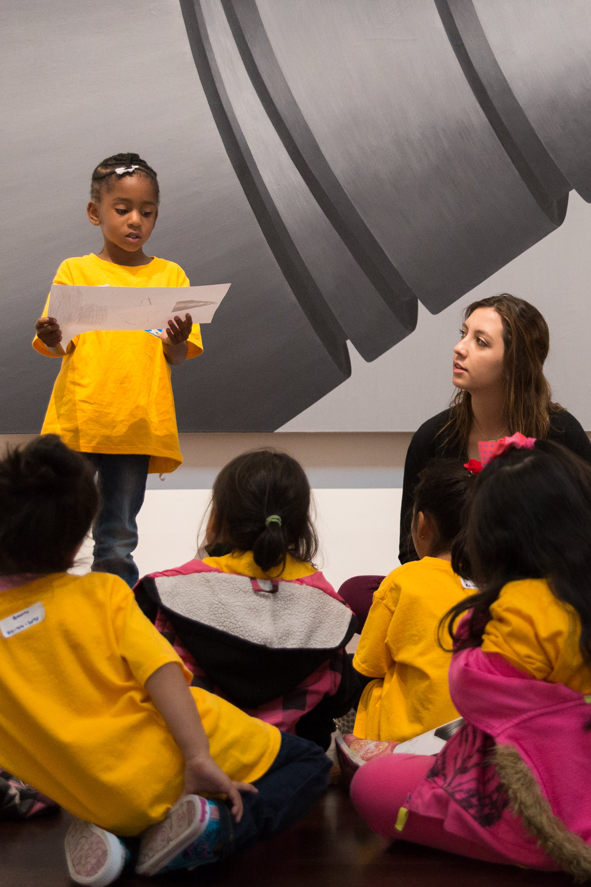 elementary school students discuss art in the Blanton museum